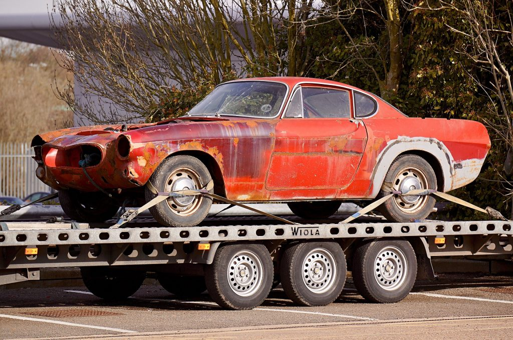 Rusty Car on a Flatbed Tow Truck | Kids Car Donations