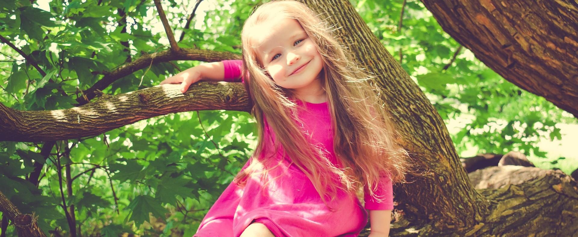 Happy Kid on a Tree in Arkansas   Kids Car Donations