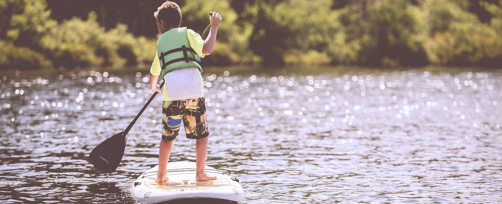 Little Boy Paddle-boating in Montana | Kids Car Donations