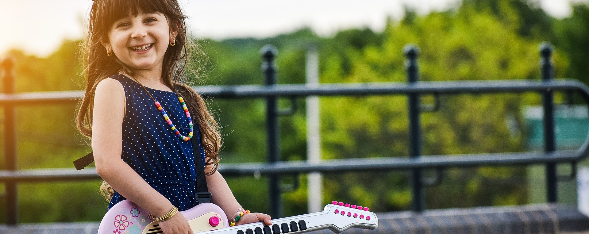 Little Girl in West Virginia enjoying her little guitar | Kids Car Donations
