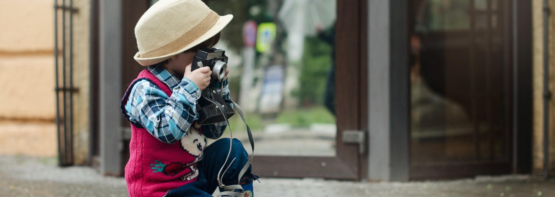 Little Photographer taking photo in New Mexico | Kids Car Donations