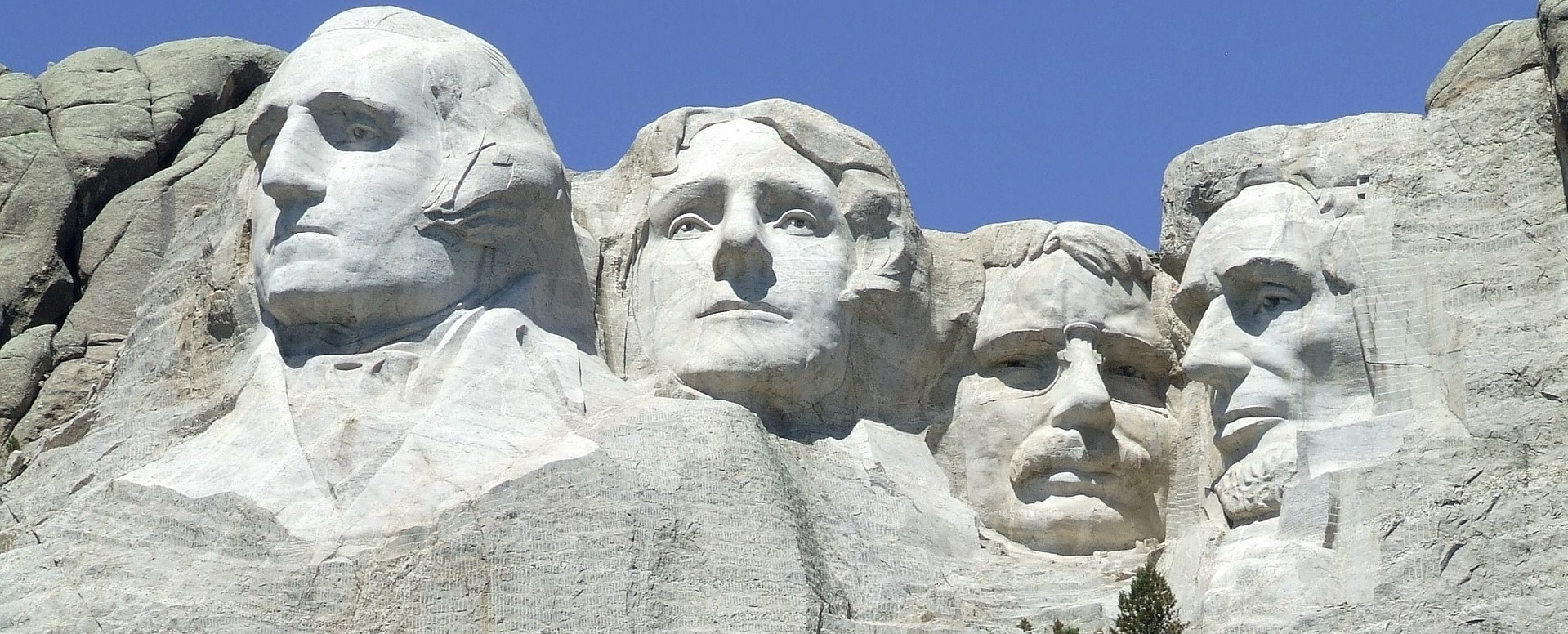 US Presidents George Washington, Thomas Jefferson, Theodore Roosevelt and Abraham Lincoln's faces sculpted in Mount Rushmore National Memoria | Kids Car Donations