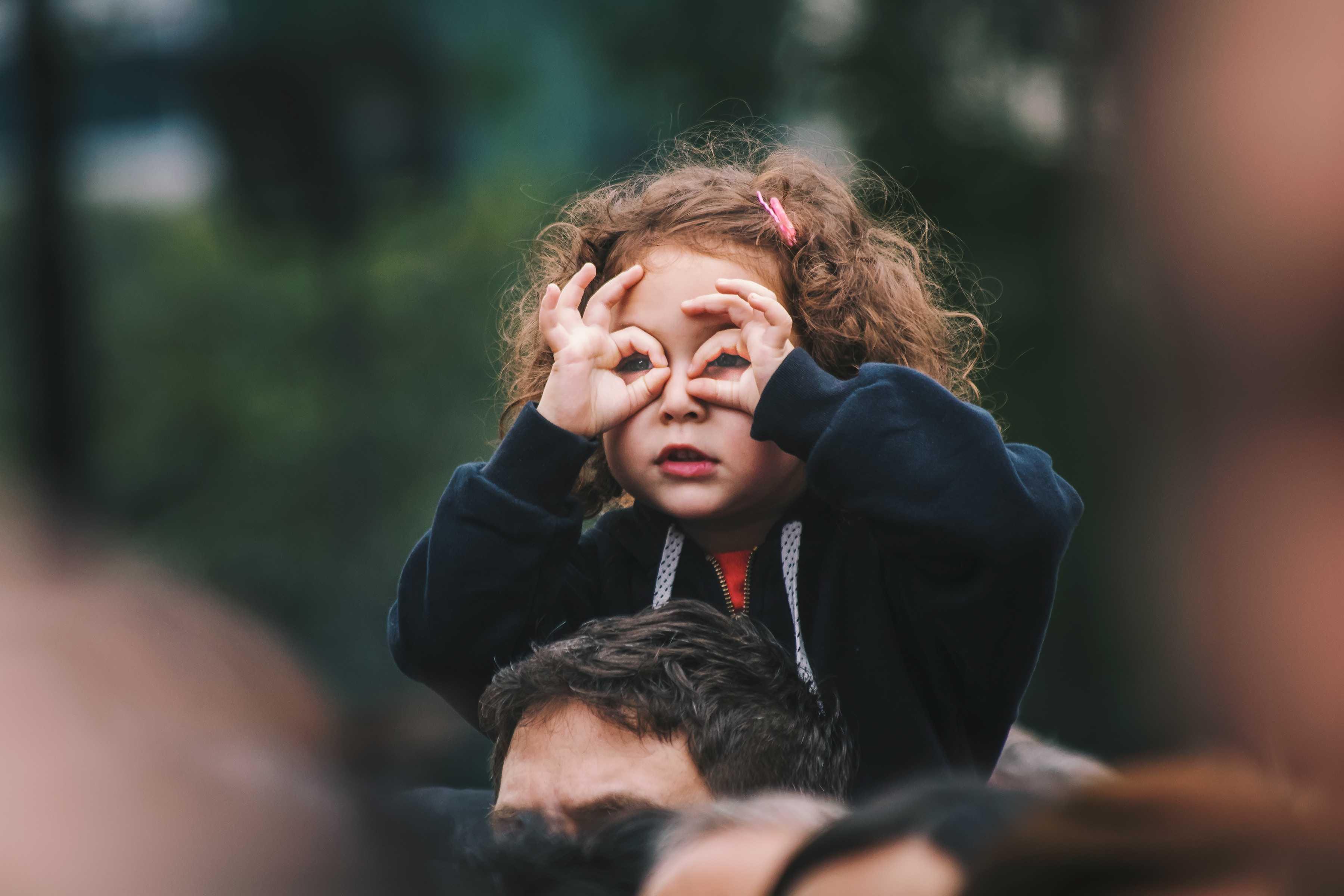 Little Kid Doing Binocular Gesture | Kids Car Donations