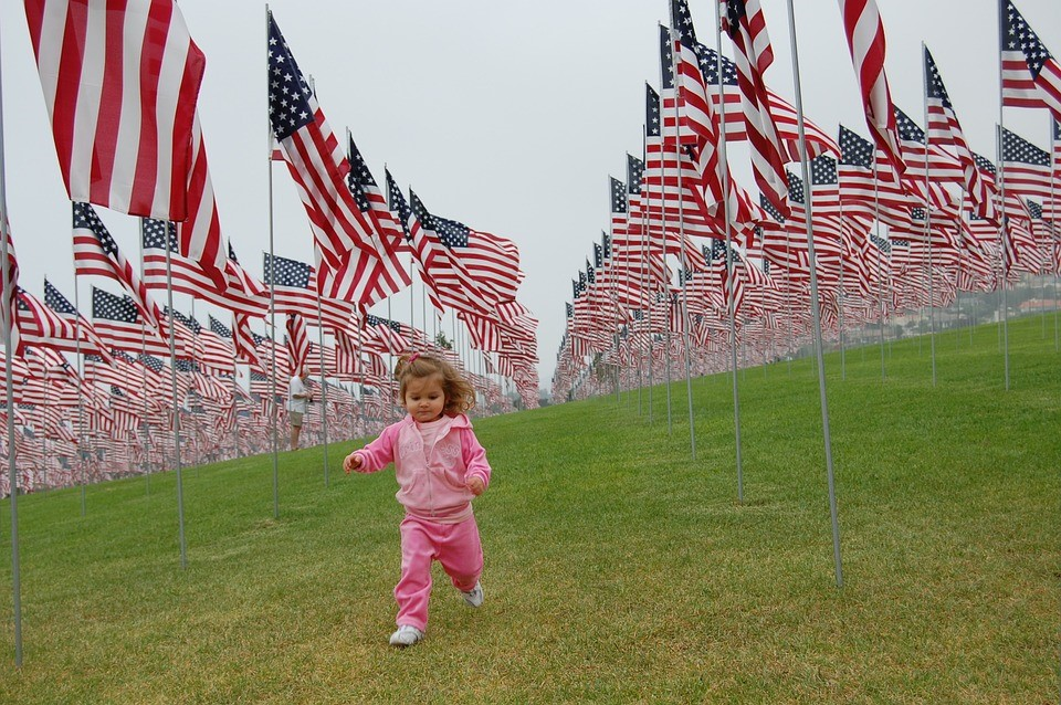 Little Girl with the American Flags | Kids Car Donations