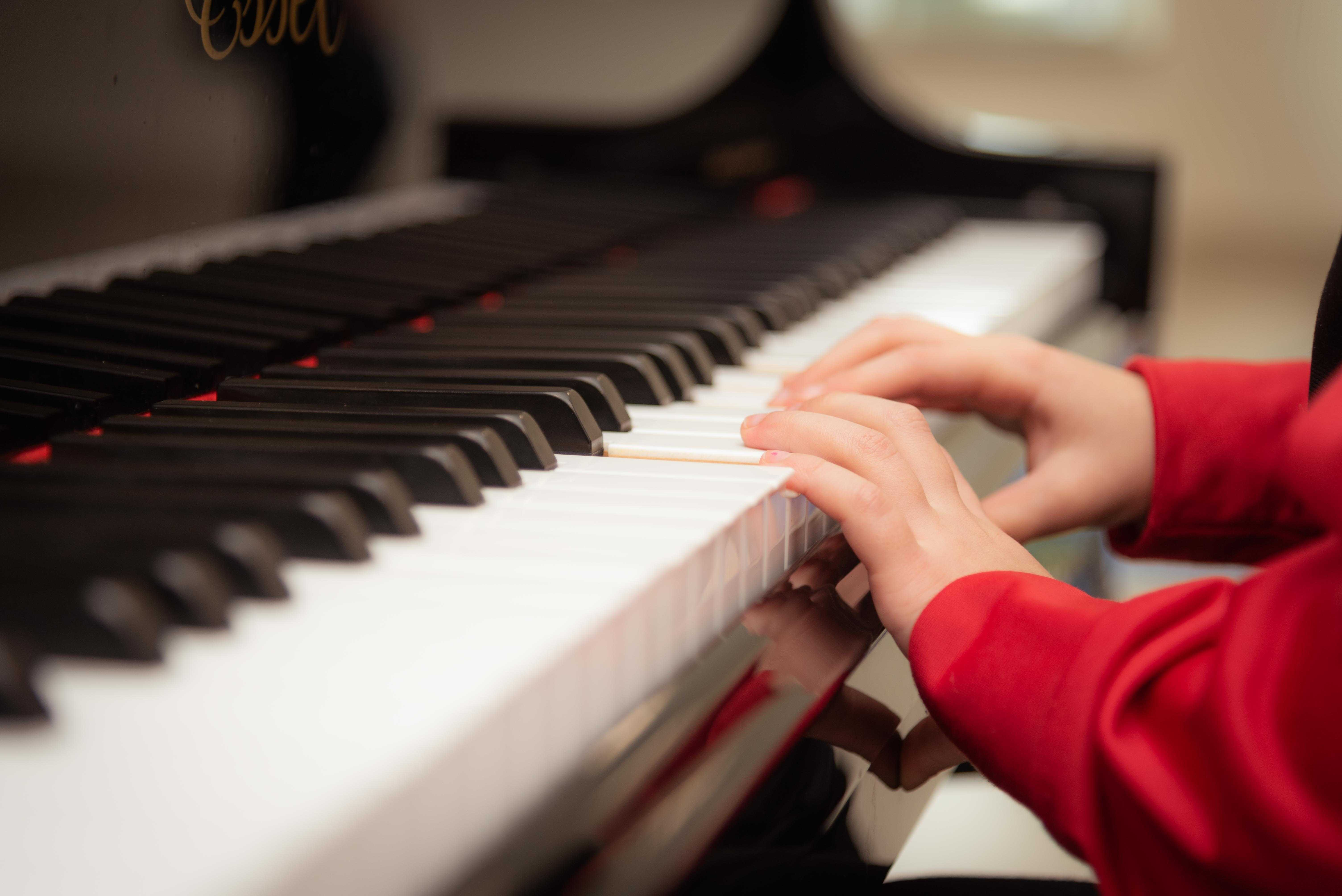 Kid Playing the Piano | Kids Car Donations