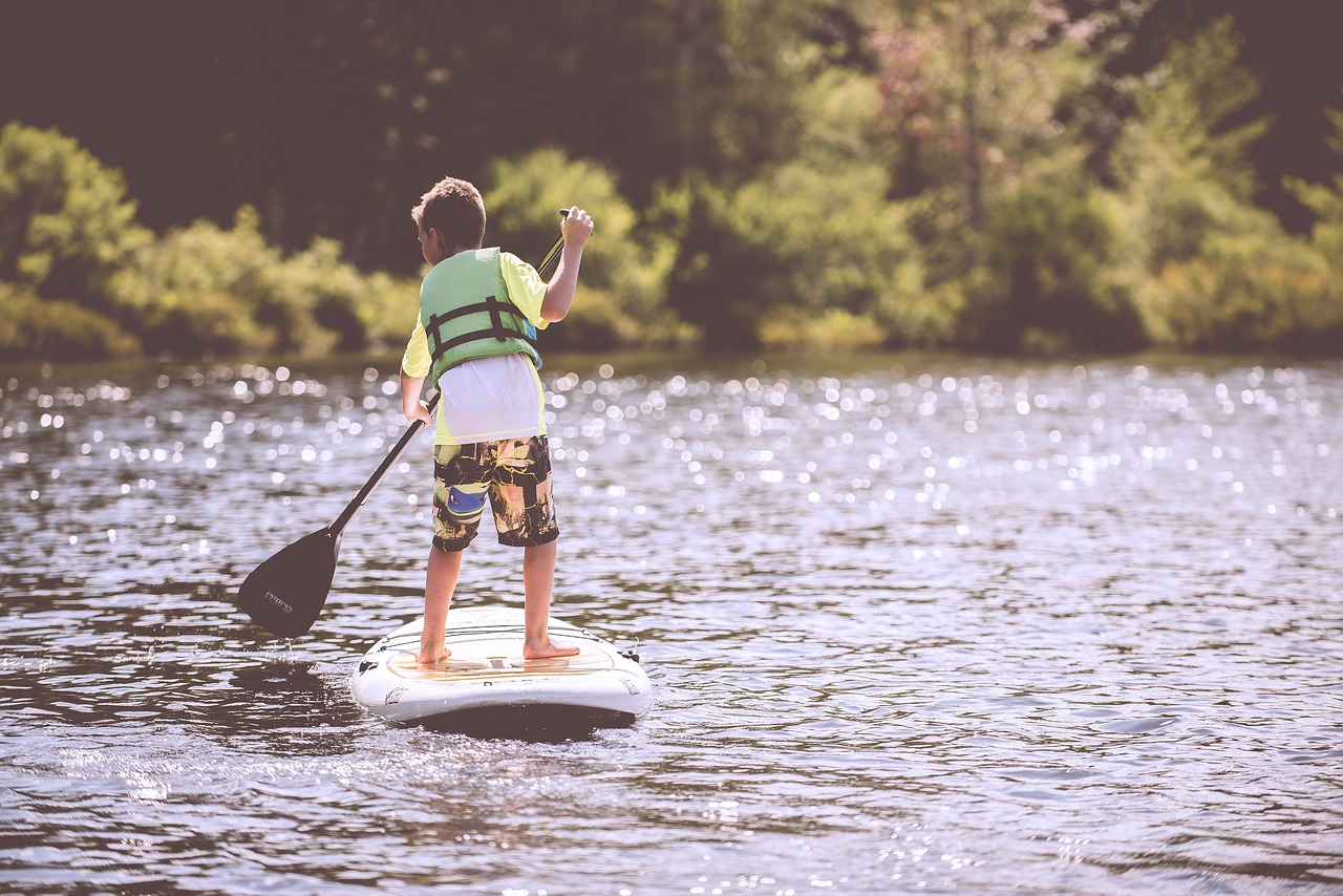 Kid on a Paddle Board | Kids Car Donations