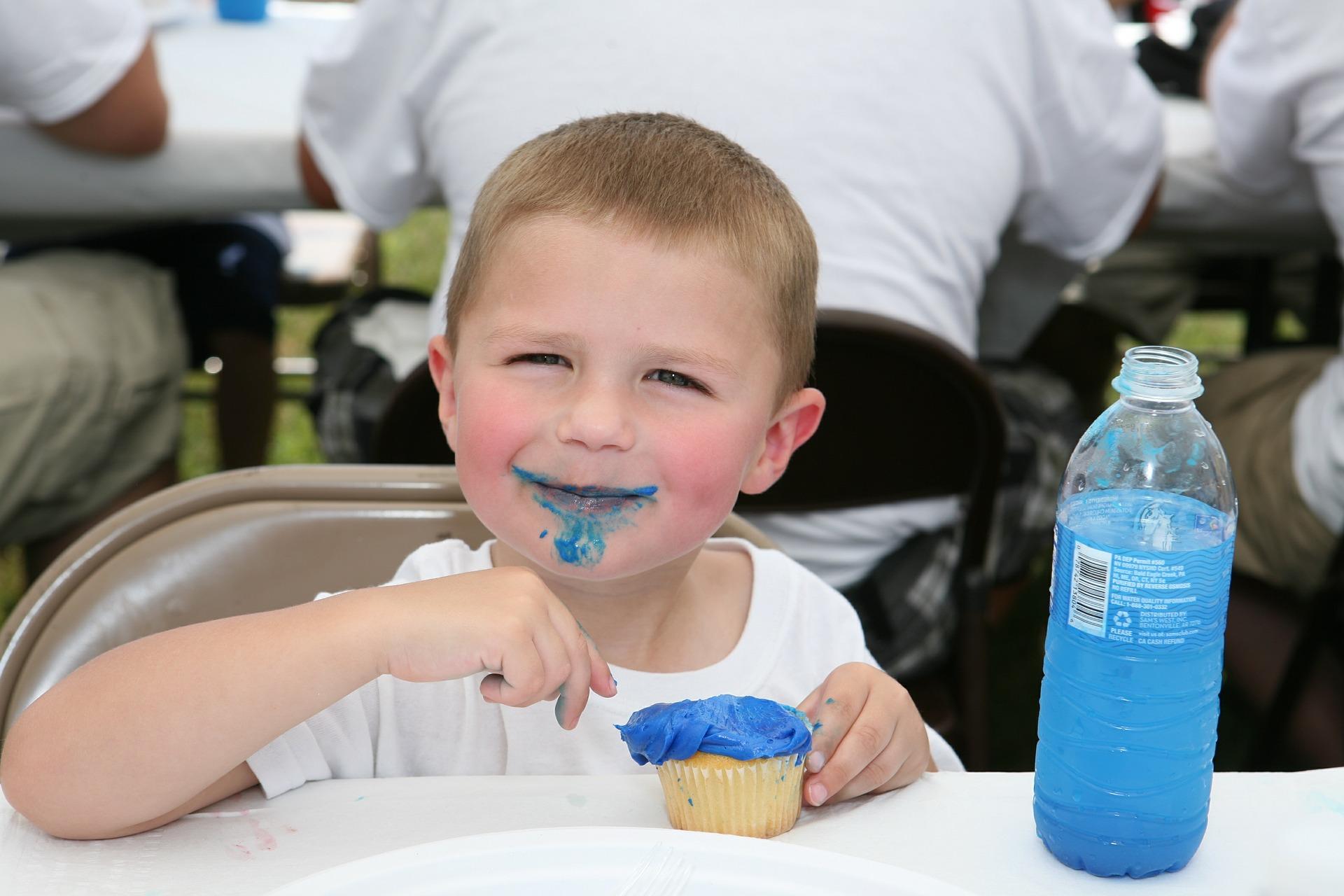 Boy Eating Cupcake | Kids Car Donations