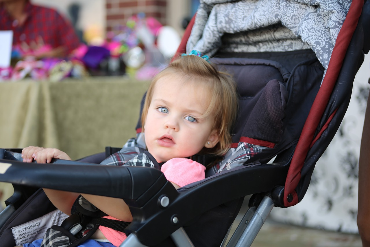 Little Girl on a Stroller   Kids Car Donations