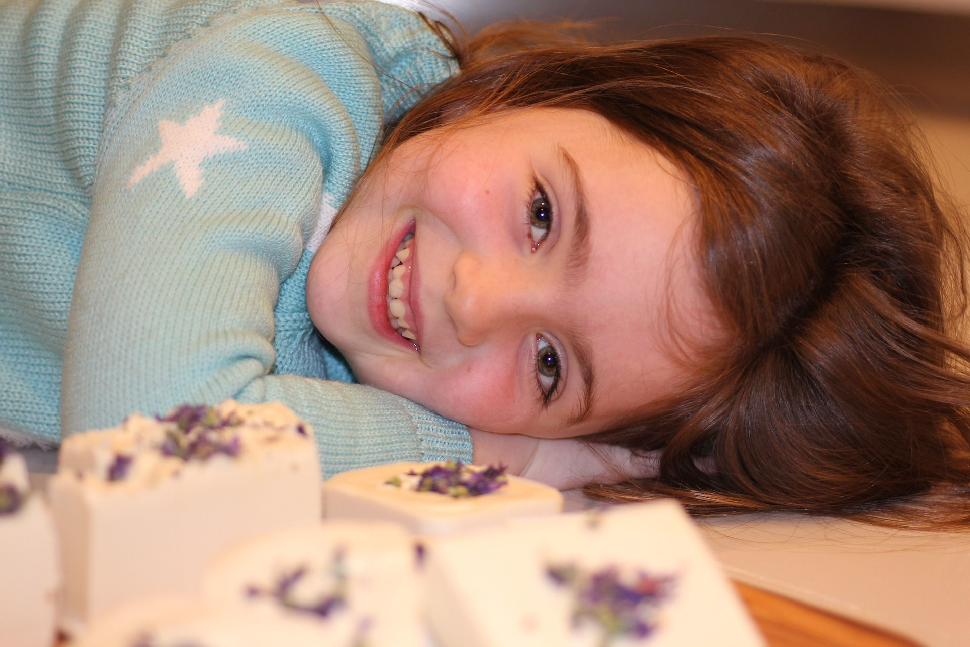 Smiling Kid as She Lies Down | Kids Car Donations