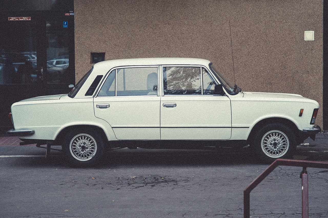 White Vintage Car on a Street | Kids Car Donations