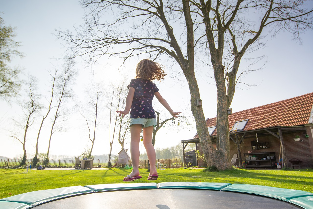 Healthy Little Girl Playing on a Trampoline | Kids Car Donations