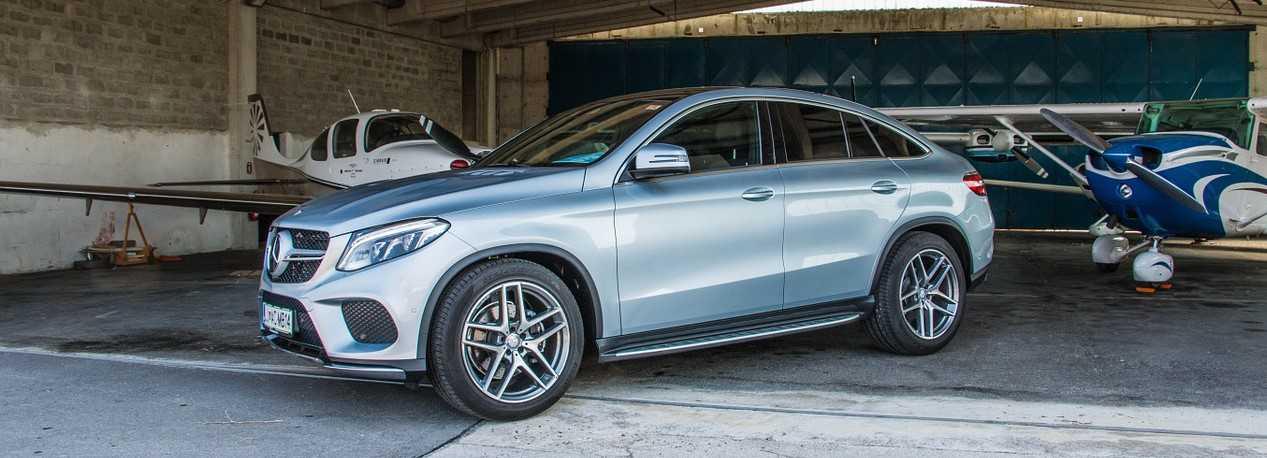 Silver Mercedes in a Hangar | Kids Car Donations