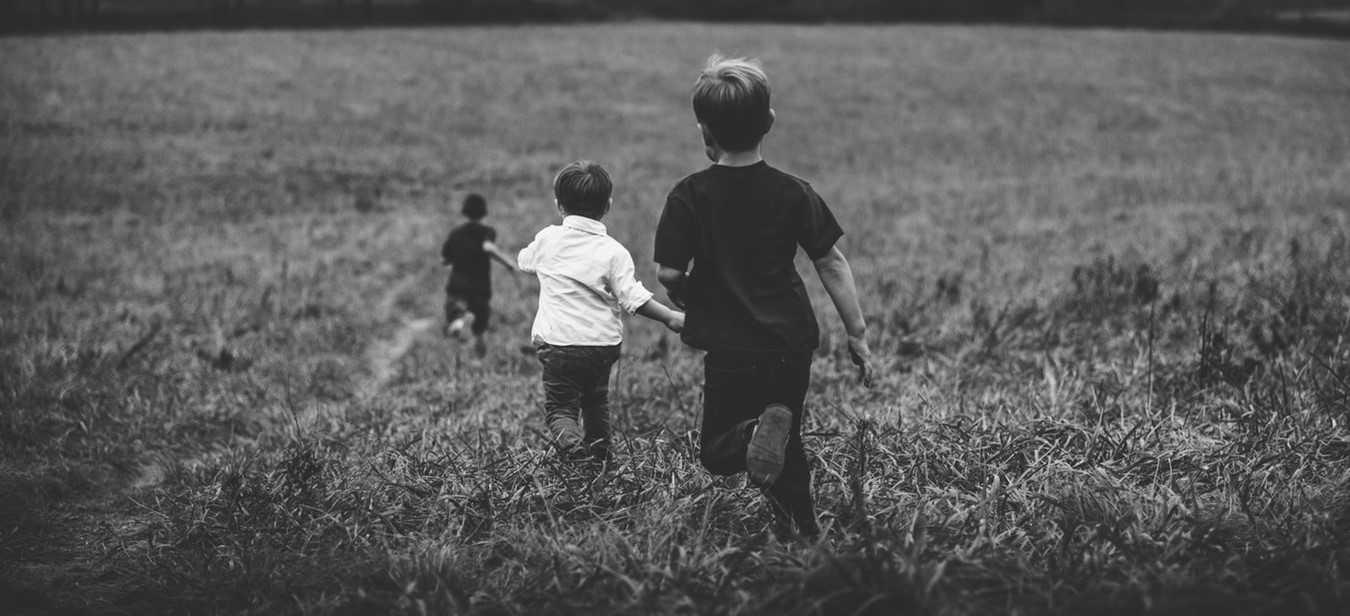 Kids Running on a Grassy Field   Kids Car Donations