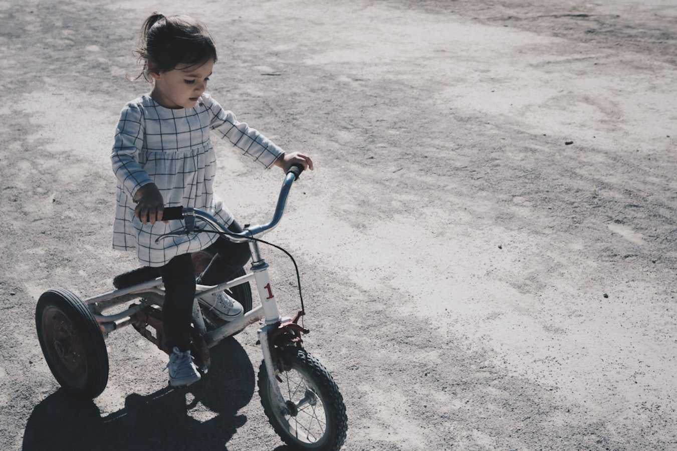 Little Girl Riding a Bicycle   Kids Car Donations