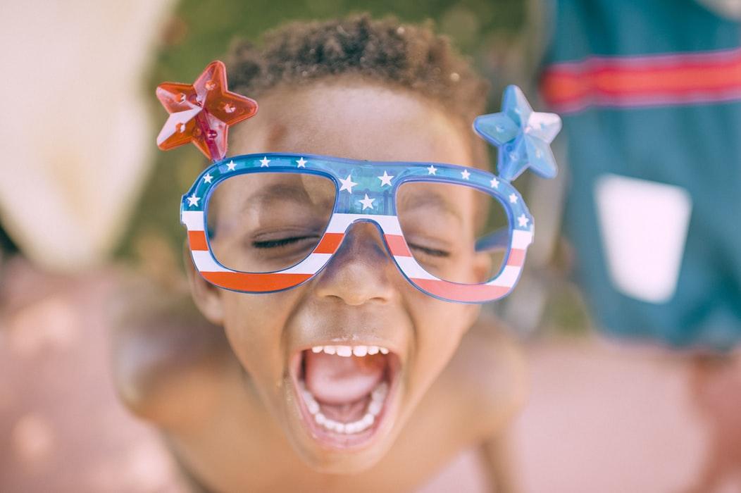 Kid Wearing Funny Glasses | Kids Car Donations