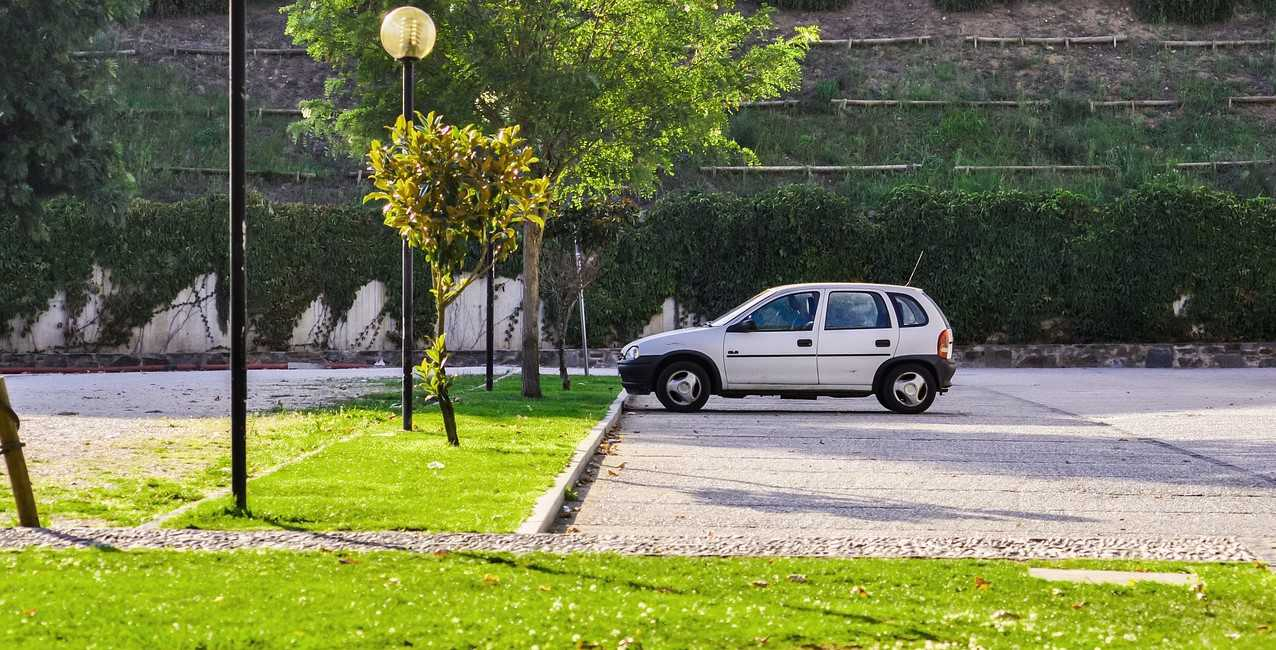 Parked White Oldtimer Car | Kids Car Donations