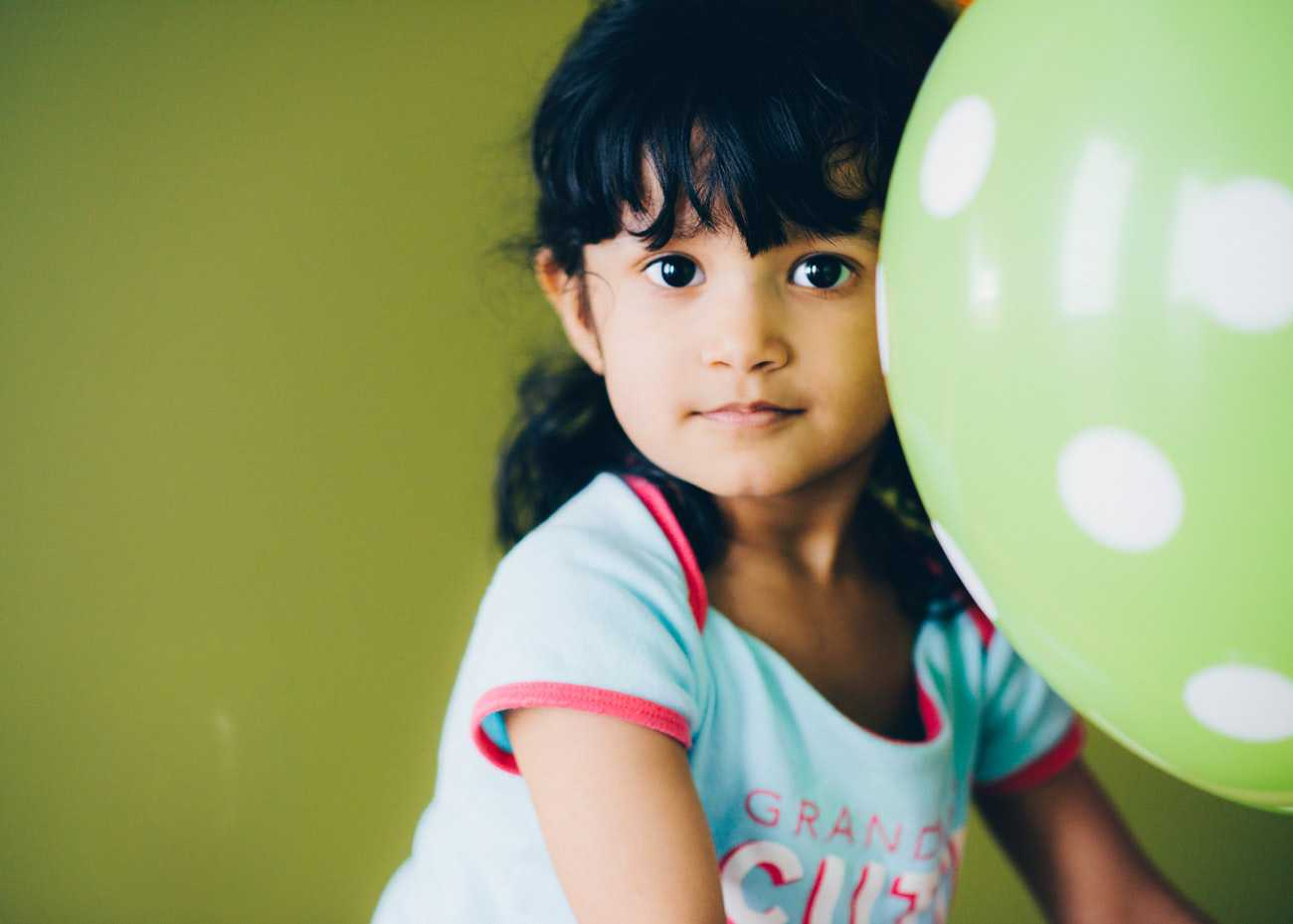 Little Girl with a Green Balloon | Kids Car Donations
