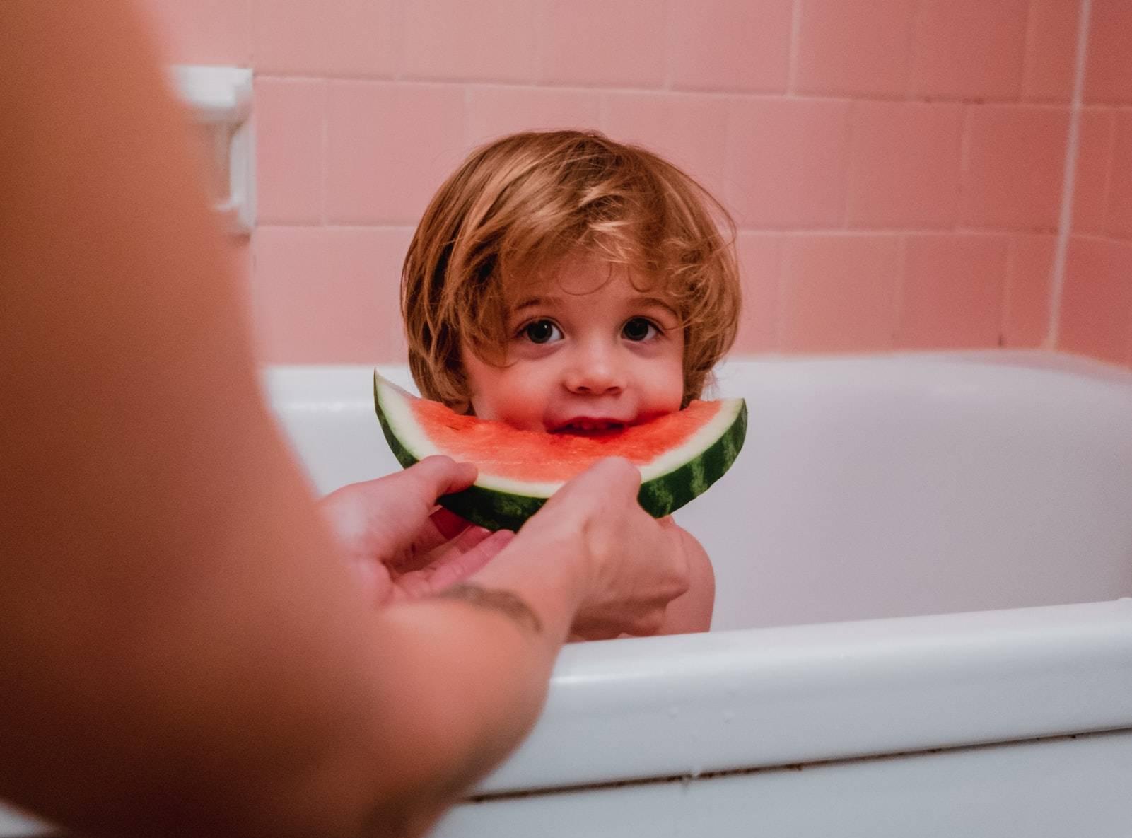 Kid Eating Watermelon Slice   Kids Car Donations