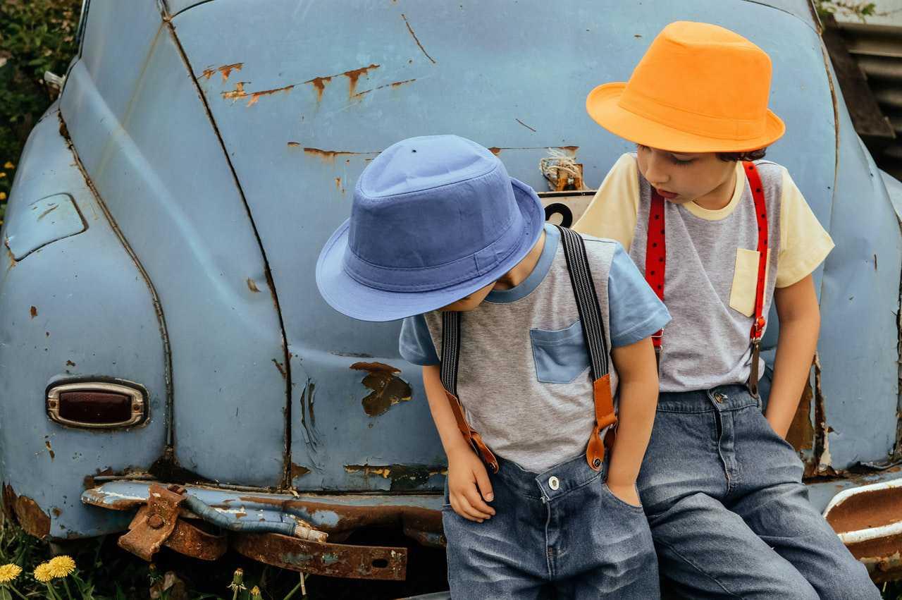 Kids Sitting on a Car | Kids Car Donations