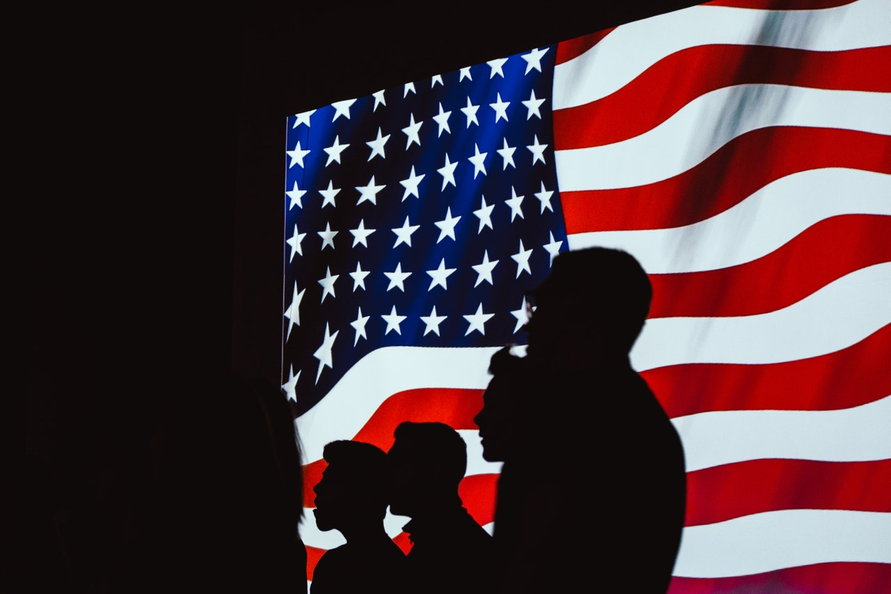 Silhouette of People Beside the US Flag | Kids Car Donations