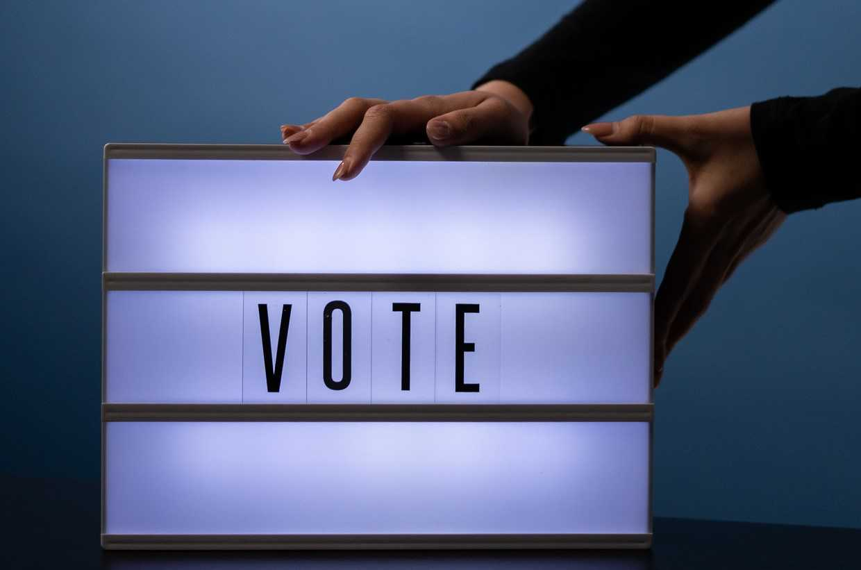 Vote Sign Placed on a Table | Kids Car Donations