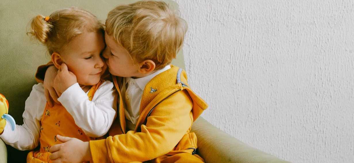 Cute Children Cuddling in Armchair | Kids Car Donations