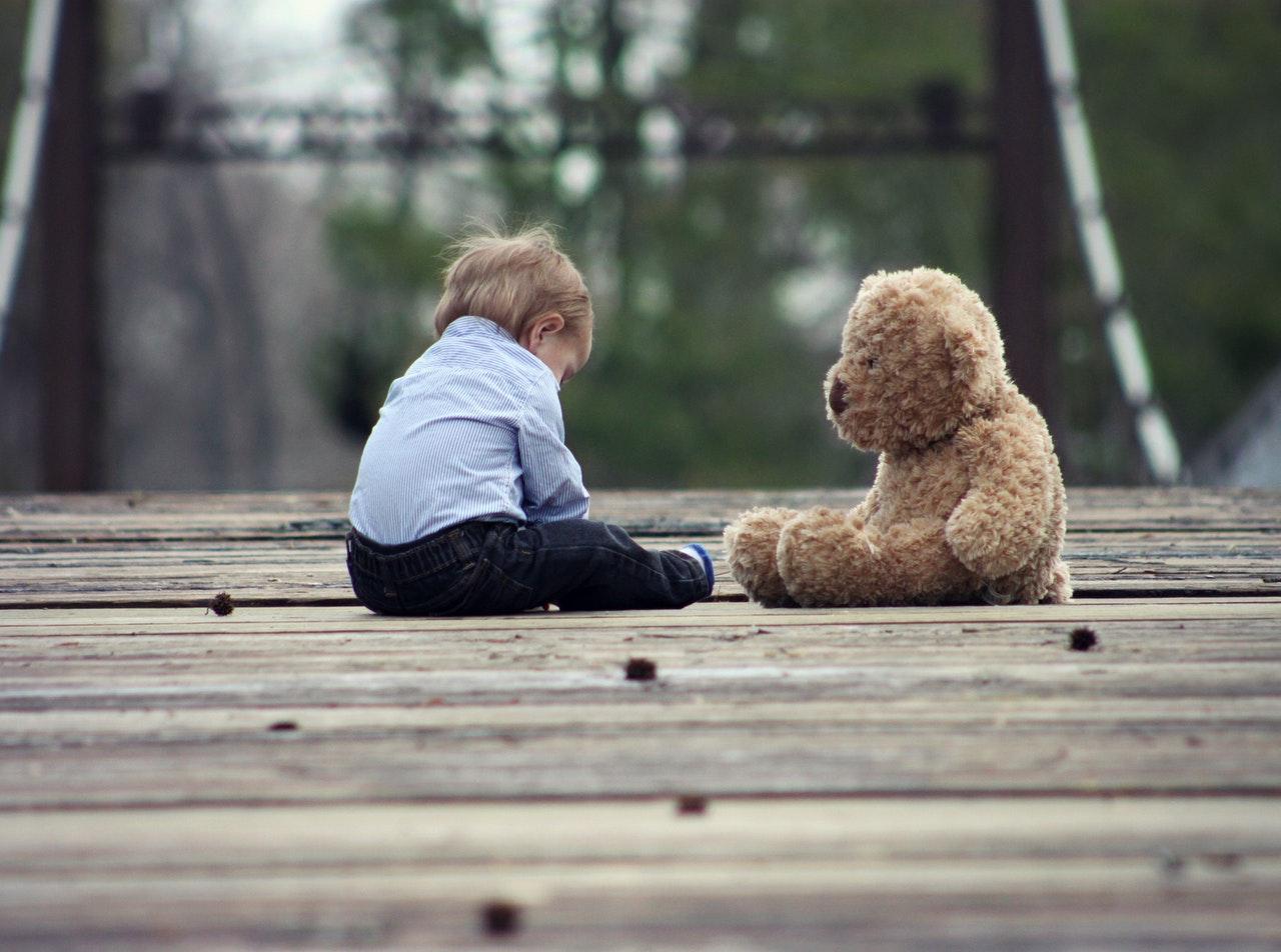 Kid with a Teddy Bear   Kids Car Donations