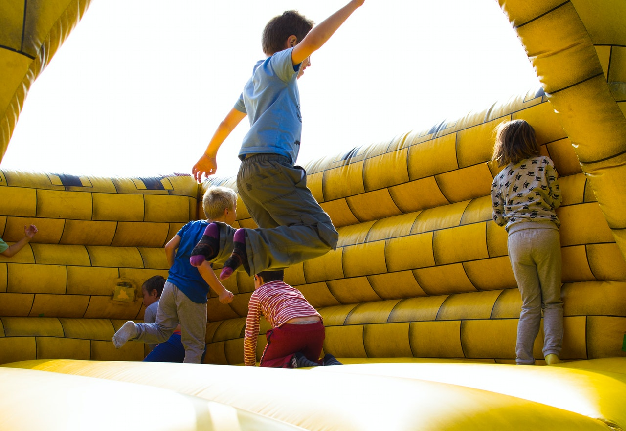 Kids Playing on Inflatable Castle   Kids Car Donations