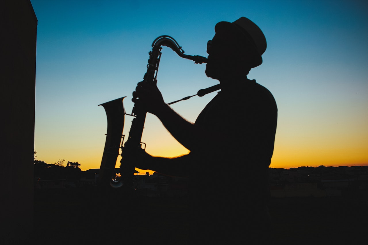 Man Playing Saxophone in Silhouette   Kids Car Donations