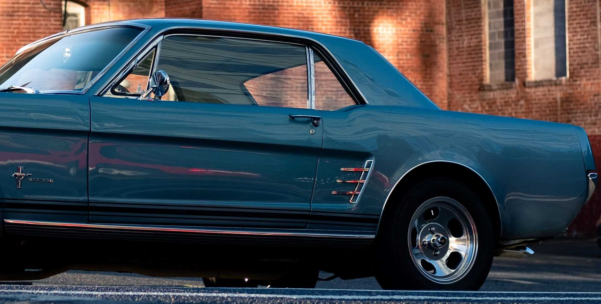 Blue Classic Car Parked on a Road   Kids Car Donations