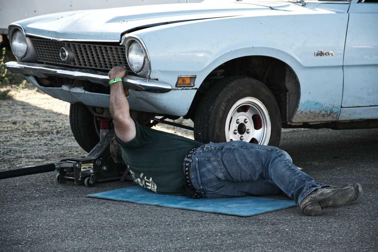 Mechanic Fixing Car   Kids Car Donations